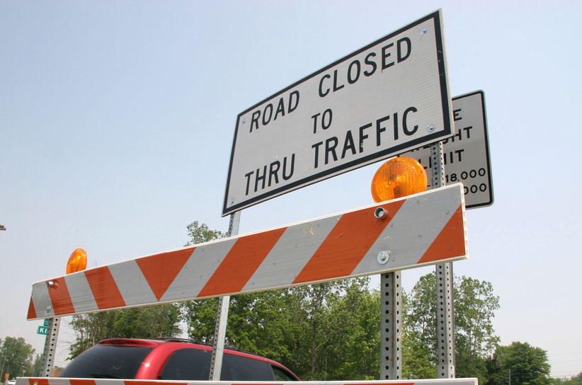 Image of a road closed sign and barricade